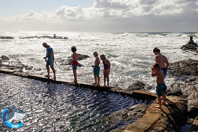 Students walking on the tidal pool wall during the OAP session on 7 September 2019