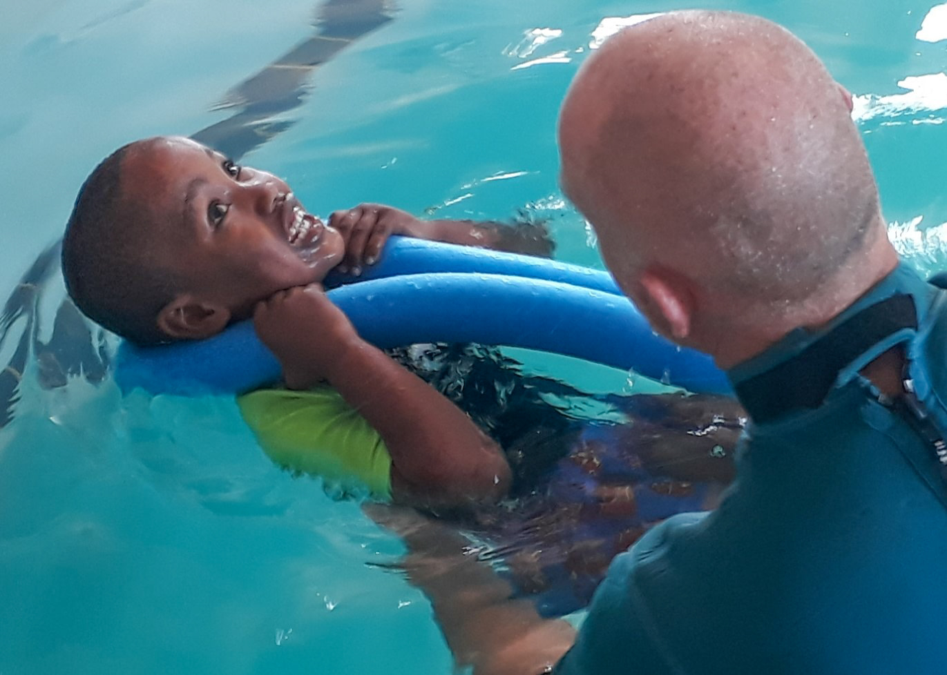 Edward in the pool with a student