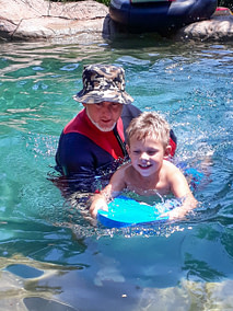 Coach Edward in the pool with a student
