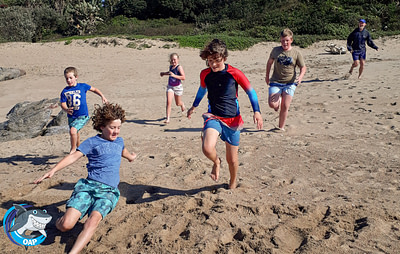 Students playing on the beach during the OAP session on 7 September 2019