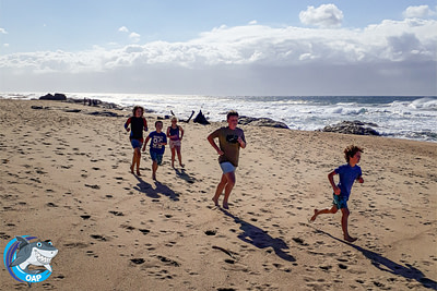 Students running on the beach during the OAP session on 7 September 2019