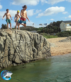 Students jumping of the tidal pool rock during the OAP session on 7 September 2019
