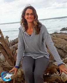 Illse Holden Smith sitting on driftwood