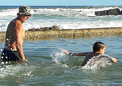 Coach Edward in the tidal pool with a student