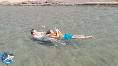 OAP kids retrieving a friend in a lifejacket