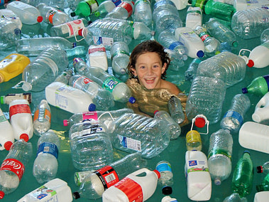Ethan swimming with plastic bottles in the pool for the Green Peace #BreakFreeFromPlastic Project
