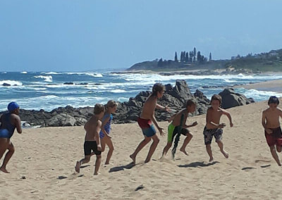 Students playing on the beach